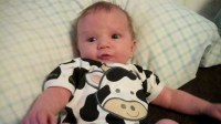 baby dressed like cow